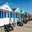 Stock Photo: A row of brightly coloured beach huts in Southwold Suffolk