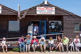 People enjoying fish and chips in Southwold Suffolk — Stock Photo