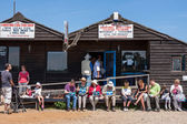 People enjoying fish and chips in Southwold Suffolk — Foto de Stock