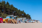 Some brightly coloured beach huts in Wells Next the Sea — Стоковое фото