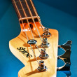 Close-up electric bass guitar head and tuning pegs — Stock Photo #38217881