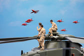 Helicopter crew watching the Red Arrows display — Stockfoto