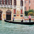 Stock Photo: Two gondoliers ferrying passengers along canals of Venice