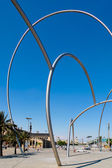 Massive metal sculpture port entrance Barcelona — Stock Photo