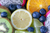 Medley of different edible fruits ready to eat — Stock Photo