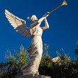 Angel playing golden bugle — Stock Photo #38649793