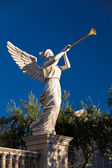 Angel playing golden bugle — Stock Photo