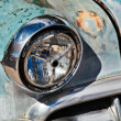 Stock Photo: Headlamp on abandoned car in Seligmon Route 66