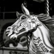 Close-up of horse on funfair carousel ride — Stock Photo #38816653