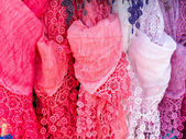 Silk scarves on display at a market stall in Fuengirola — Stock Photo