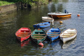 Group of rowing boats full with rainwater — Stock Photo