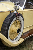 Spare wheel on a vintage yellow Rolls Royce car — Stock Photo