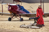 Bedouin guarding WW1 aircraft in the desert — Stock Photo