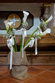 Peace Lilies on display in a church in Pienza — Stock Photo