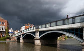 Woman looking over Eton bridge as a storm approaches — Stock Photo