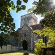Stock Photo: St Clement Parish Church, gravestones and trees in bright sunlig