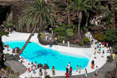 People walking round the swimming pool at Jameos del Agua — Stock Photo