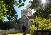 St Clement Parish Church, gravestones and trees in bright sunlig — Stock Photo