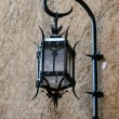 Stock Photo: Close-up of cast iron and glass lamp in Monte Carlo