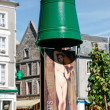 Green bucket on top of advertising poster in Boulogne France — Stock Photo #40037377