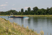 Barge cruising down the Rhine south of Strasbourg — Stockfoto
