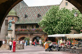 View of a statue and a group of people sightseeing in a courtyard in Strasbourg — Stock Photo