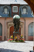 View of a statue three people holding a sphere in a courtyard in Strasbourg — Stock Photo