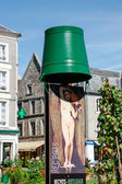 Green bucket on top of an advertising poster in Boulogne France — Foto de Stock