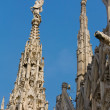 Close-up view of some spires and statues of Duomo Cathedral — Stock Photo #40284351