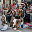 Stock Photo: Buskers dressed as americred indians making music in Milan