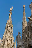 Close-up view of some spires and statues of the Duomo Cathedral — Stock Photo