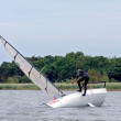 Stock Photo: Yachtsmattempting to right his dinghy on Hickling Broad