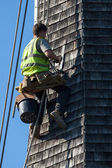 Steeplejack working on the church roof at Horsted Keynes — Stock Photo