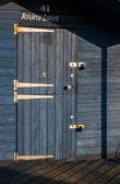 Padlocked door of beach hut — Stock Photo