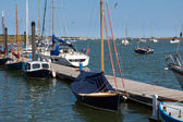 Boats moored at a jetty in Wells — Stock Photo