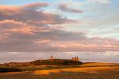 Sunset at Dunstanburgh Castle — Stock Photo