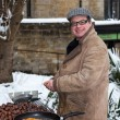 Stock Photo: Man selling hot chestnuts