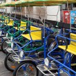 Stock Photo: Row of four wheeled bikes