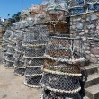Lobster pots stacked against the harbour wall in Brixham — Stock Photo