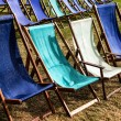 Deckchairs after passing shower — Stock Photo #41478879