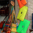Brightly coloured bags for sale in Pienza — Stock Photo