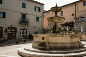Fountain in the square at Castiglione d'Orcia — Stock Photo