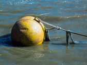 Huge yellow buoy floating in the River Thames — Foto Stock