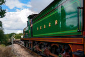 C Class steam engine leaving Sheffield Park station — Stock Photo