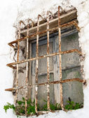 Rusting bars across a window of a derelict building in Casares S — Stock Photo