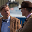 Two men deep in converation at the Goodwood Revival — Stock Photo #47716423