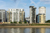 Various styles of buildings along the River Thames — Stock Photo