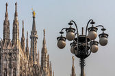 Spires of the Duomo Cathedral and street lamps in Milan — Stock Photo
