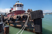 Old tugboat moored at the jetty in Sausalito — Stock Photo