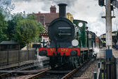 C Class steam engine leaving Sheffield Park station East Sussex  — Stock Photo